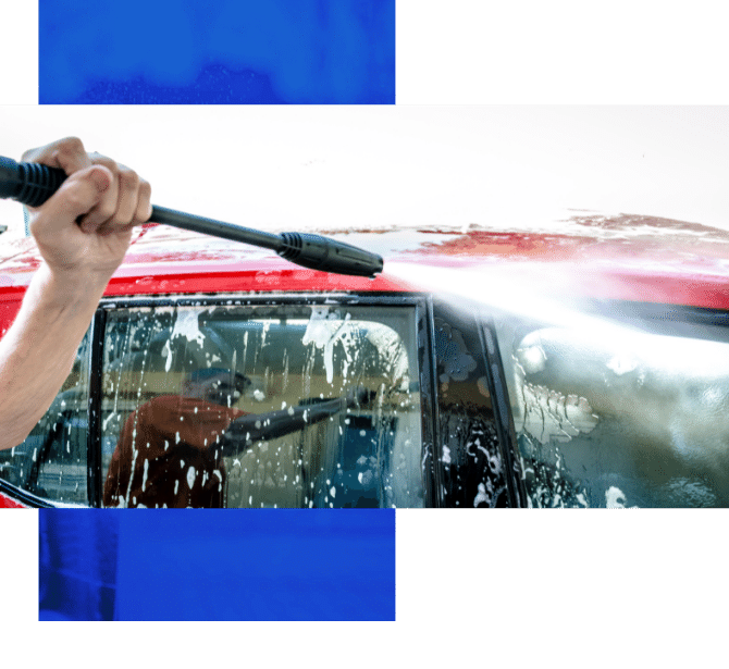 Image depicts a car owner power washing their car.