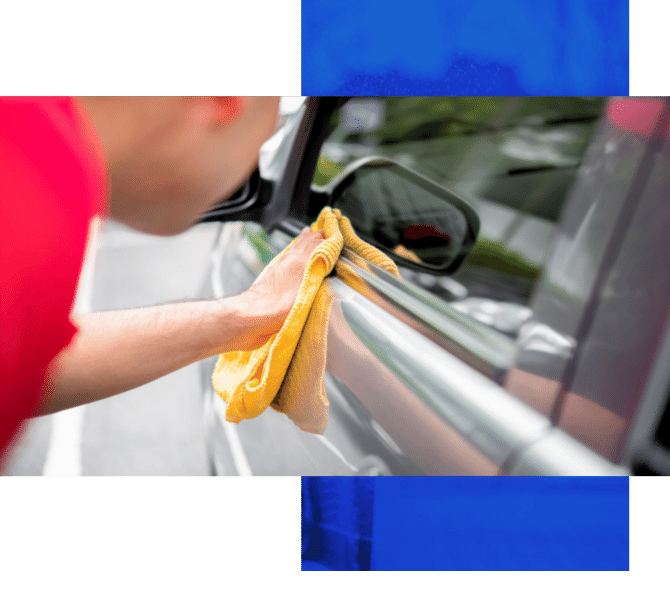 Image depicts a car owner cleaning their car.