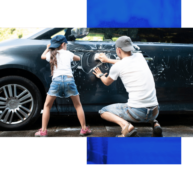 Image depicts a father and daughter cleaning a car with detailing products.